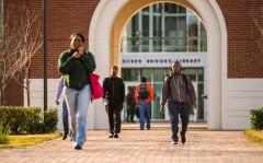 Students walk past the NSU Communications Tower on Wednesday, November 18, 2015. (Tigermoth Photo/Chris English)